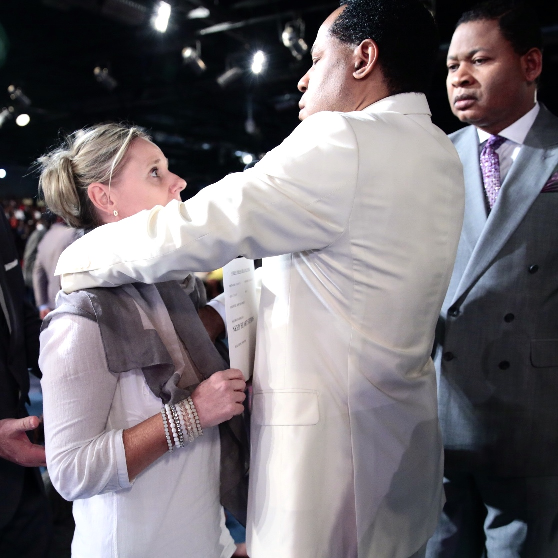 Pastor Chris Ministering to The Sick